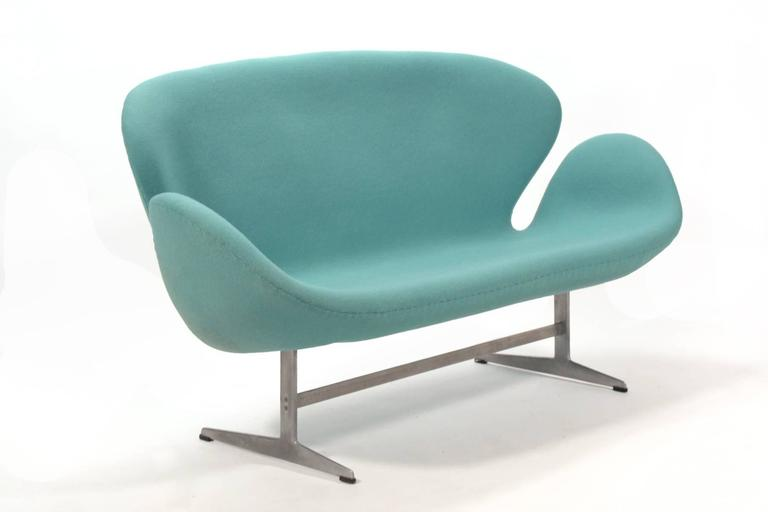 Originally created for the SAS Hotel in Copenhagen, this is Arne Jacoben's sofa version of the famous Swan chair. Designed as a companion piece to the swan and egg chair. It's an elegant form that is light in scale as well as a comfortable seat.