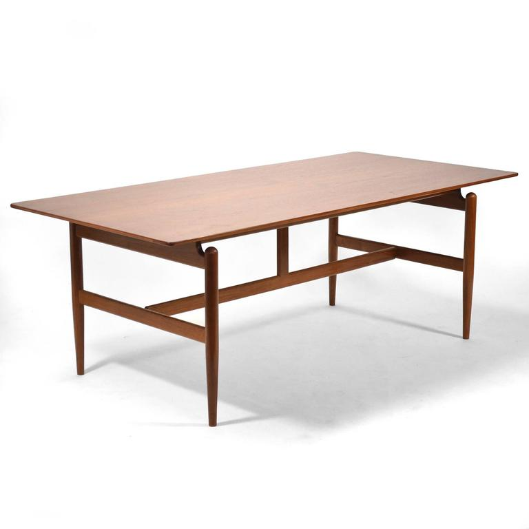 Finn Juhl designed this beautiful desk or work table for his own home before licensing it to Baker Furniture who offered it as model no. 520. Also known as the Kaufmann table, the substantial table with a floating top can also be used for dining.