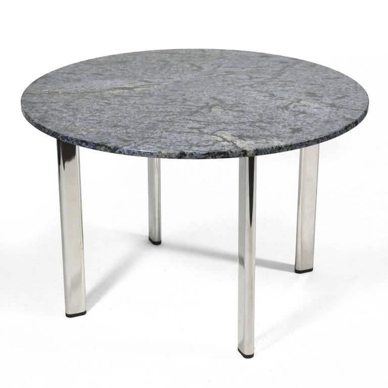 """Joe D'urso's Minimalist/ Industrial chic aesthetic translated perfectly in his furniture designs manufactured by Knoll. This table features four oval legs of chrome-plated steel set at 45 degree angles.  This table has a beautiful 42"""" round piece"""