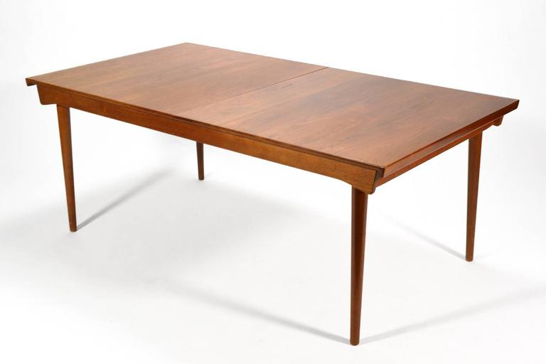 Danish master Finn Juhl's importance cannot be understated and whether he was collaborating with Neils Vodder or France & Sons his sensibility shines. This table is a perfect example. Crafted of solid teak, it features a top with sculpted ends which