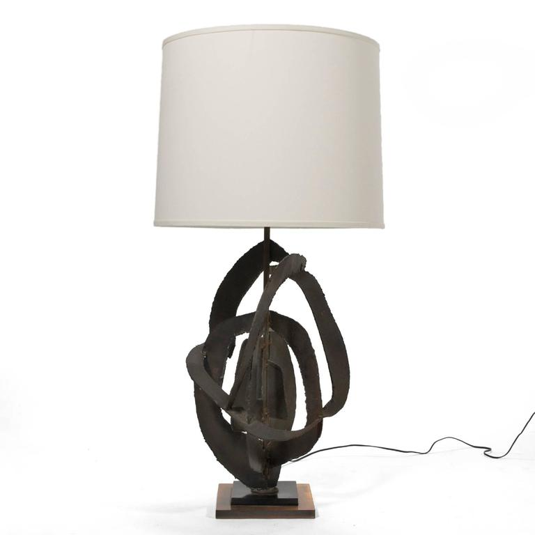 This terrific table lamp by Harry Balmer has a powerful sculptural steel base. They dynamic form, scale and textured steel give it great presence. It has been fitted with a new drum shade.