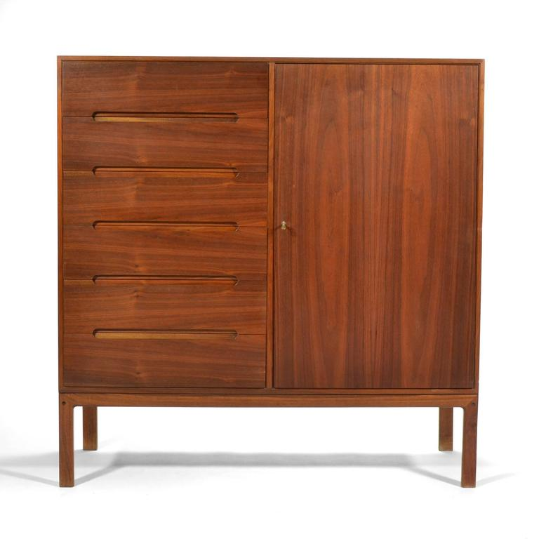 A spectacular design by Arne Wahl Iversen, this teak gentleman's chest is as functional as it is beautiful. The left side features a bank of drawers with beautiful recessed pulls while the right side has a locking door that conceals a bank of