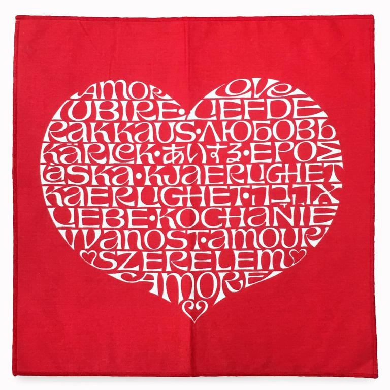 Girard's International heart features the word LOVE in 19 languages and was designed in 1961 for the Textile and objects shop which Alexander Girard created for Herman Miller as a boutique showroom of textiles designed by Girard and a selection of
