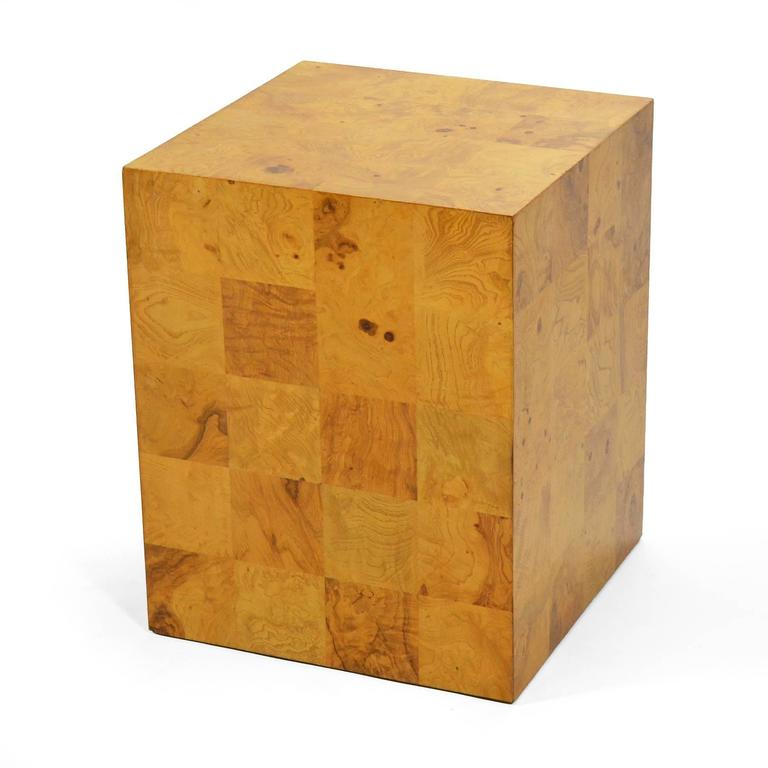 This design by Baughman is as spare as it is serviceable. The Minimalist form is embellished with a patchwork of rich burled veneer and the scale allows it to serve perfectly as an end table, lamp table, or pedestal for art or objects.