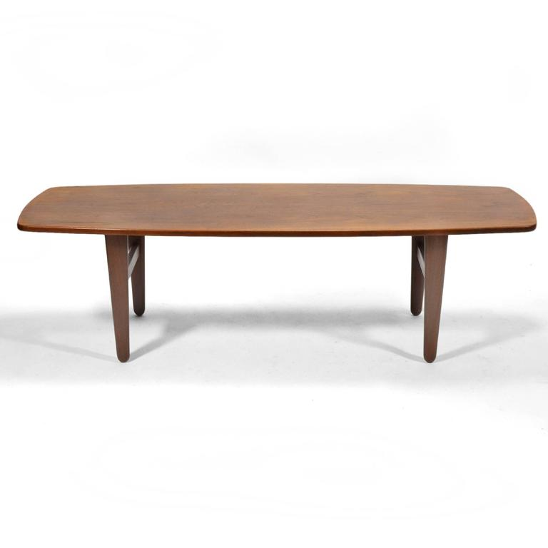 Wonderful teak Svend Madsen coffee table by K. Knudsen & Son with softly curved lines and tapered legs.