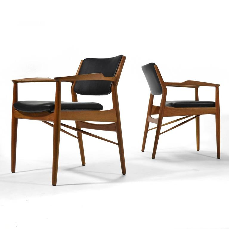 These model 51A Arne Vodder armchairs typify Danish modern as popularized by Finn Juhl. Beautifully crafted by P. Olsen Sibast Møbler, the sculptural teak frames support upholstered seat and backs accentuating their floating quality. 