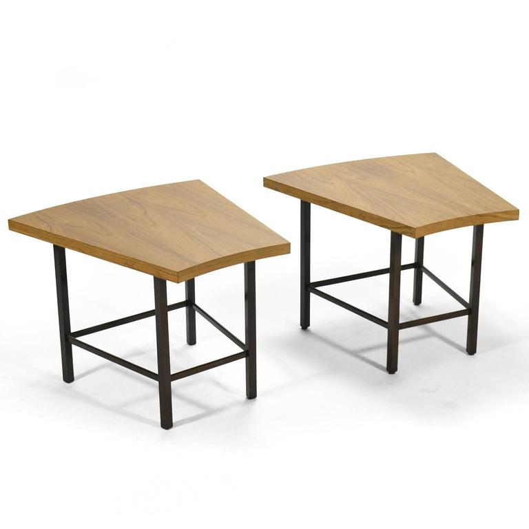 This lovely pair of trapezoidal tables by Harvey Probber have tops of bleached rosewood supported by mahogany bases. The combination of curved and straight lines are especially pleasing. They function perfectly as side tables, end tables or