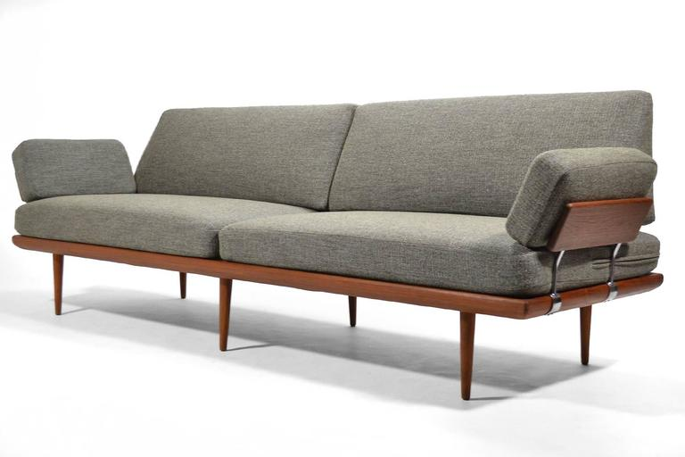 Finely crafted by France & Søn, this rare, extra large version of the Minerva sofa or daybed has a frame of solid teak with steel fittings and comfortable spring cushions which have just been upholstered in a richly textured gray fabric. 