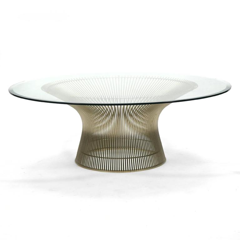 Warren Platner's landmark 1966 collection for Knoll exhibits a grace and beauty that belie the technical virtuosity of the designs. A wire sculpture that captures space and delights the eye, this coffee table has a chrome base and is topped with a