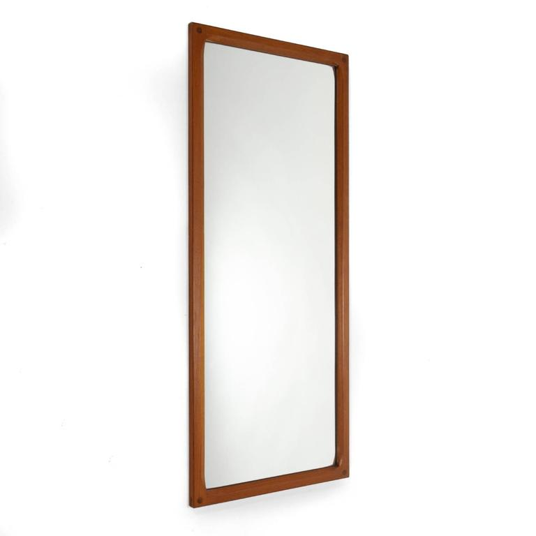 This Aksel Kjersgaard wall mirror by Odder has a beautifully crafted solid teak frame. The interior edges are deeply scalloped and the corners have wonderful exposed joinery.