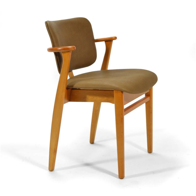 A wonderful 1946 design by Ilmari Tapiovaara, the Domus chair was offered entirely of wood, with an upholstered seat, or an upholstered seat and back. This nice example, has beautiful new leather upholstery .   The scale of the design and the