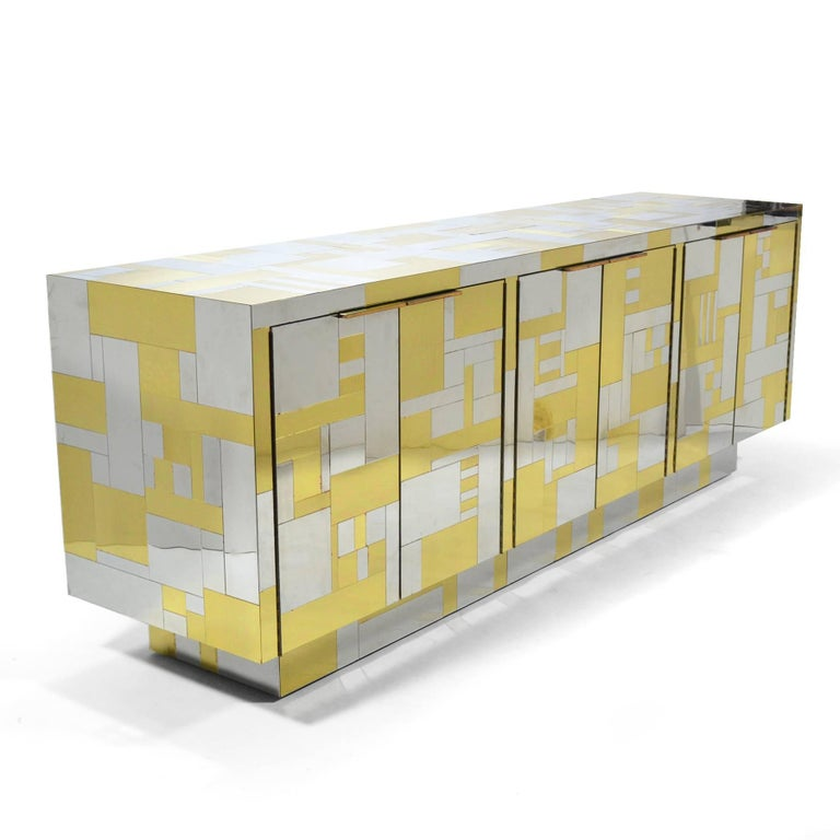 This stunning credenza is from Evans' PE200 Cityscape series and has the most pleasing composition of brass and chrome patchwork.