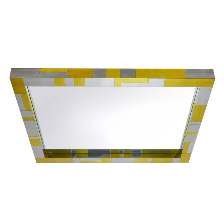 This wall mirror by Paul Evans is from Paul Evans'