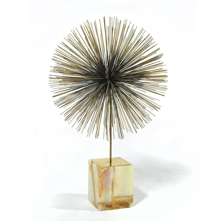 Probably our favourite of all the dandelion or sunburst sculptures created by Jeré is this table top version which features a single round form supported atop an onyx base.
