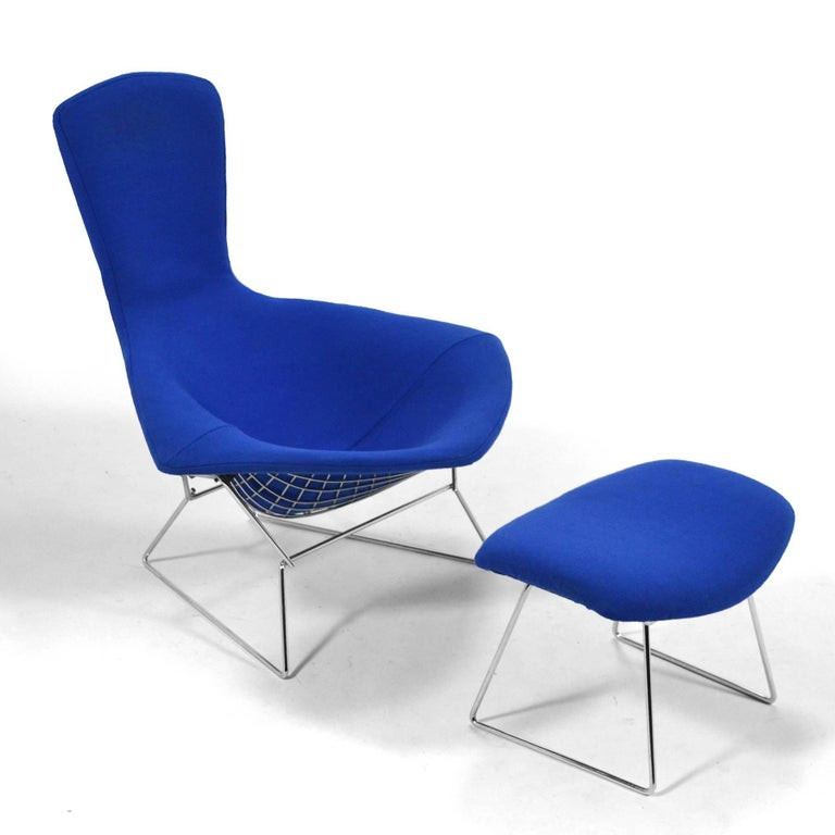 This early bird chair and ottoman by Harry Bertoia for Knoll has a frame of chromed steel and a vivid blue cover. The fame is the cleanest we've ever seen and the fabric is in great original condition. We have had the original cover cleaned and