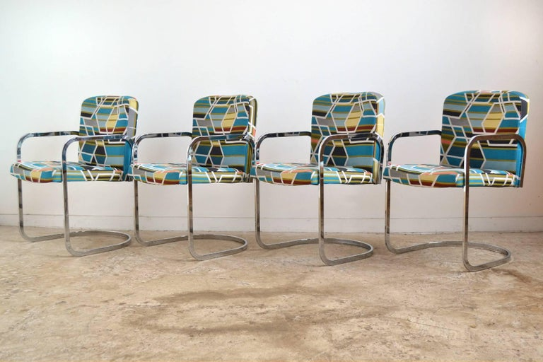 This set of armchairs by D.I.A. clearly take inspiration from Mies van der Rohe's Brno chairs. The chairs have chrome steel frames which support seats newly upholstered in Maraham fabric