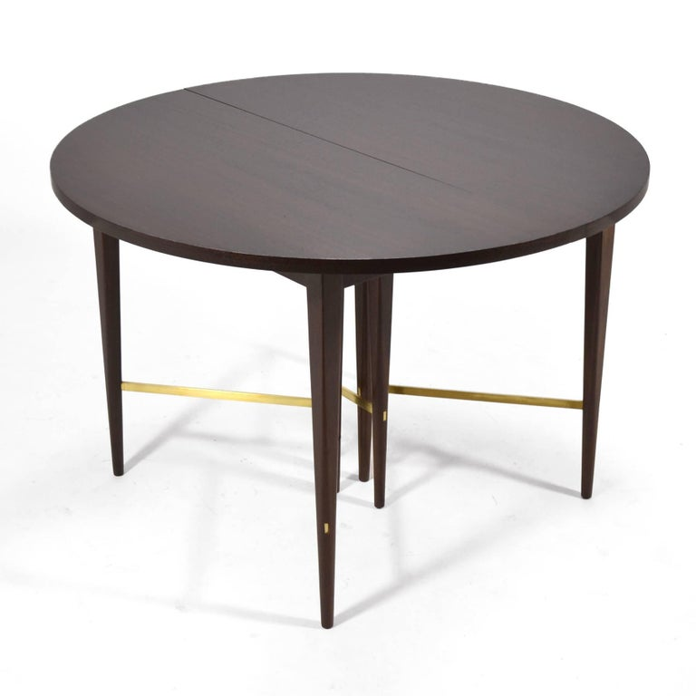 This exceptional Paul McCobb dining table by Calvin has six 12 5/8
