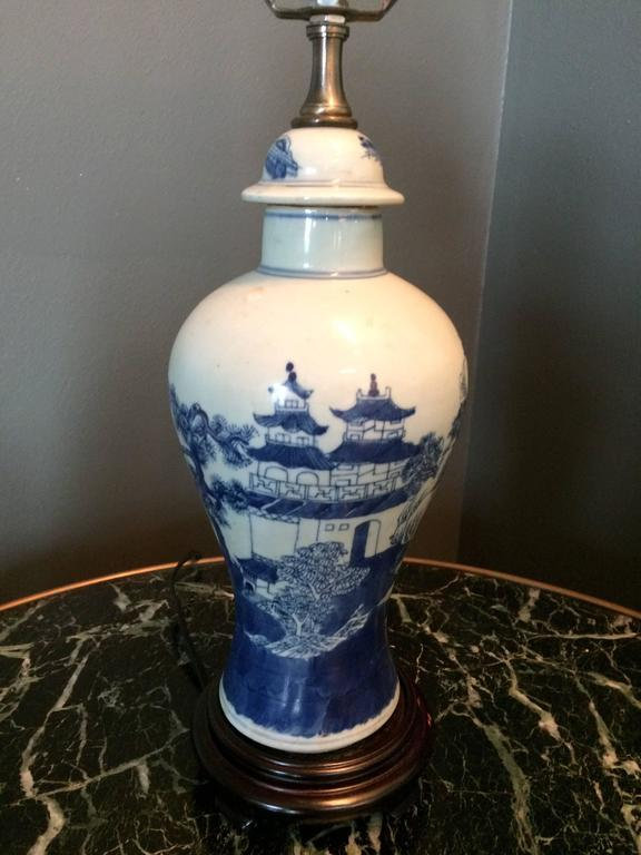 A small charming blue and white Chinese Export baluster jar mounted as a lamp on a teakwood base.