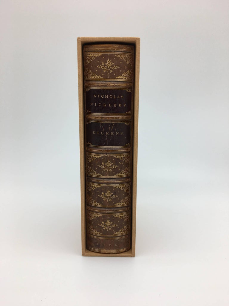 Dickens, Charles. The Life and Adventures of Nicholas Nickleby. London: Chapman and Hall, 1839. Bound in period in leather and housed in a custom cloth slipcase with a portrait of the author on the cover.  First edition of Dickens' third novel and