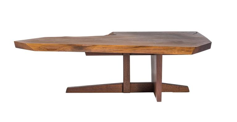 "Excellent Nakashima walnut coffee table atop a rare Ming II base. Nice expressive top with sap edge and a crotch cut edge. Signed and dated ""George Nakashima 1968"" This table and the following two coffee tables listings are from the same collection."