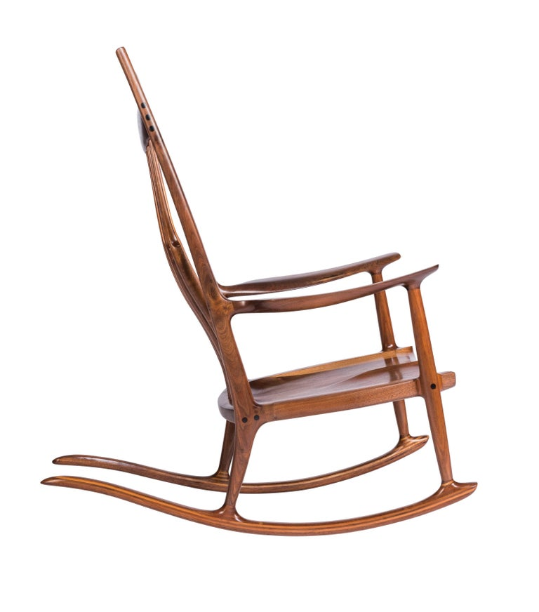 A perfect and unique example by noted California woodworker Sam Maloof. His iconic rocker defined his work and were made for two U.S. Presidents and dignitaries globally. Constructed in walnut with ebony inlay, creating a beautiful contrast of