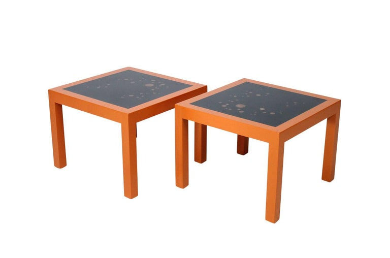 A rare pair Wormley for Dunbar end tables with orange lacquered frames, black tops, and an array of walnut inlays. Signed with metal Dunbar label.