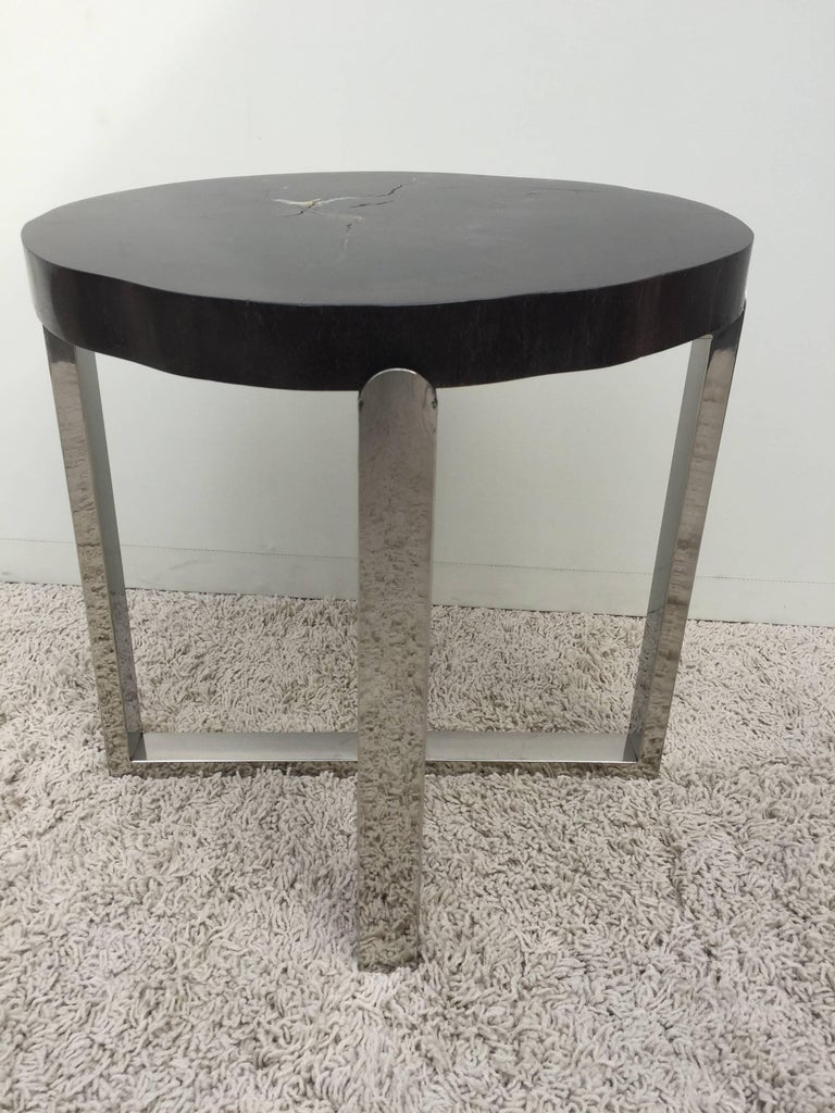 Pair of petrified wood black and crème vein, polished handmade chrome base, petite side tables. Unique one of a kind. With criss-cross continuous base.
