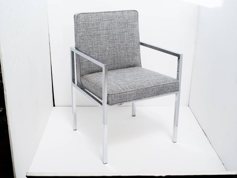 Handsome mid-century desk chair or side chair with sleek cantilevered chromed frame.  Newly upholstered in woven Rogers & Goffigon fabric in hues of steel blue and grey heather (cotton/linen).  There are two chairs available and sold separately.
