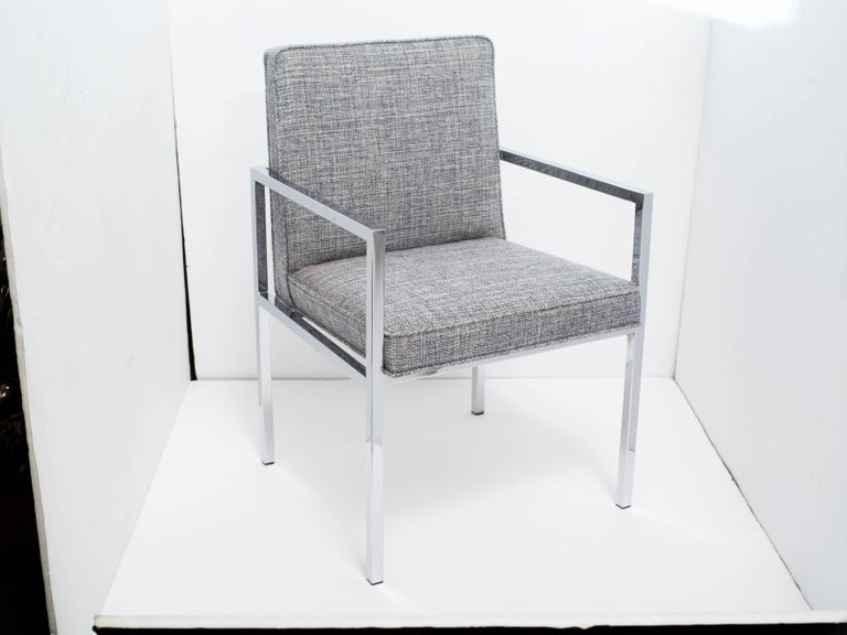 Mid-century modern desk chair or side chair with sleek cantilevered frame in polished chromed steel. Newly upholstered in woven Rogers & Goffigon fabric in hues of steel blue and grey heather (cotton/linen).