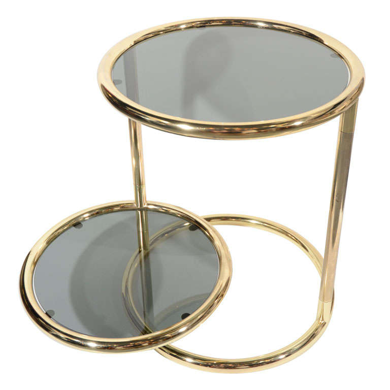 Mid-Century Modern two-tier side table with extendable top. Brass frame with adjustable and rotating second tier allowing the table diameter to extend from 18