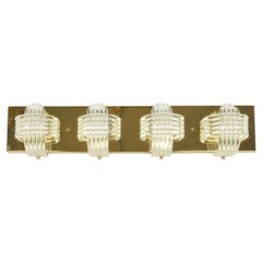 Hollywood Regency Sculptural Lucite and Brass Wall Light by Lightolier