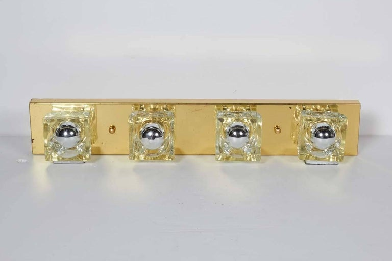 Mid-Century Modern wall light featuring four cubist glass block shades. Streamline frame in polished brass with handcut glass and brass ball fittings. Can be is mounted vertically or horizontally. Make great powder room or vanity lights sconces.