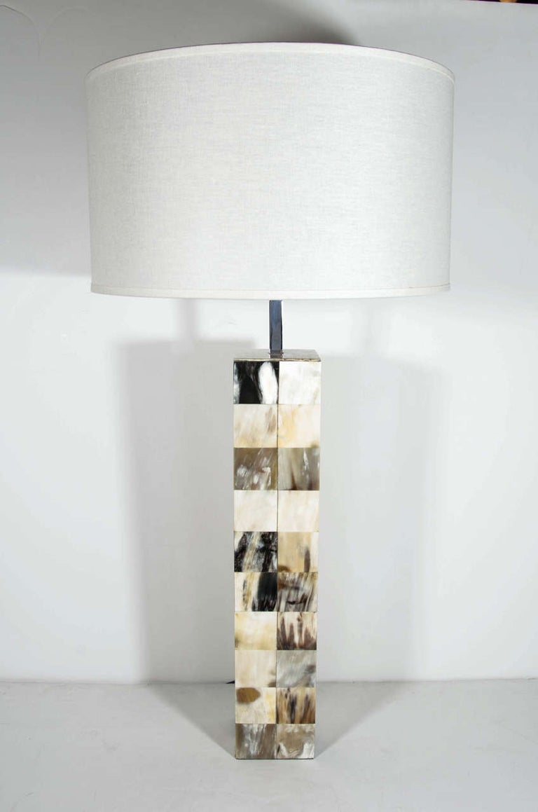 Mid-Century Modern lamp in genuine bone. Column design comprised of inlaid Horn squares in hues of ivory, grey, black, brown and camel. Features a chrome stem and newly rewired.