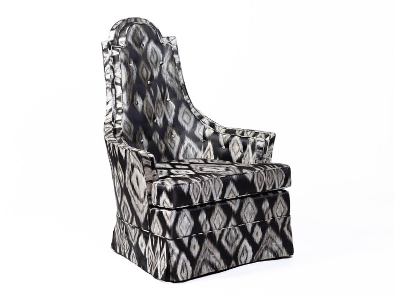 Pair of Mid-Century Modern armchairs with sculptural high back design. Newly upholstered in graphic black and platinum Ikat silk fabric with geometric print. Chairs have tall shield shaped backs with a gorgeous profile. Features button back accents