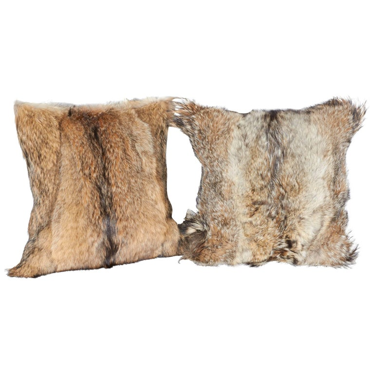 Ultra luxury decorative pillows. Handcrafted from genuine coyote fur in hues of, tan, camel, ivory and brown, with the occasional black streaks. Each pillow is unique in coloration and texture, and features handstitched backing in Fine khaki colored