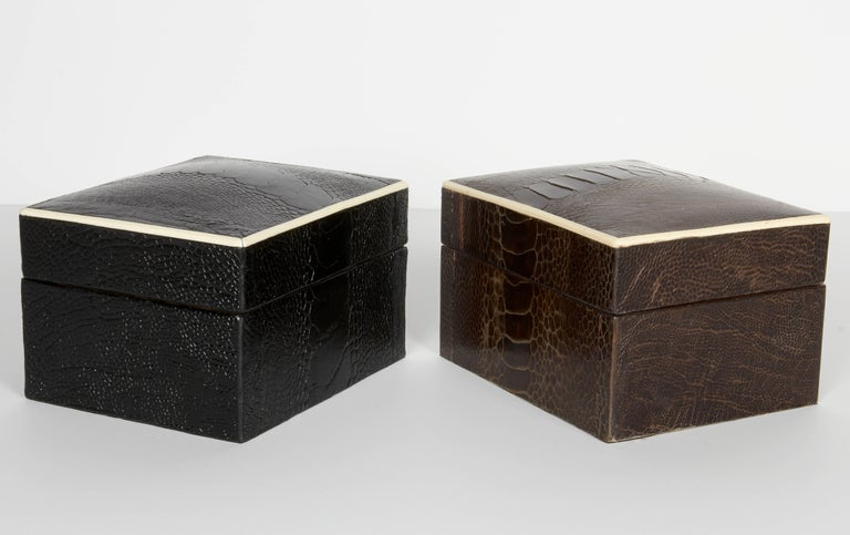 Stunning organic modern decorative boxes wrapped in exotic ostrich leather with bone inlay trim. All handcrafted in fine leather available in espresso brown or black ebony, with palm wood interiors. Mid-century modern style make great desk and