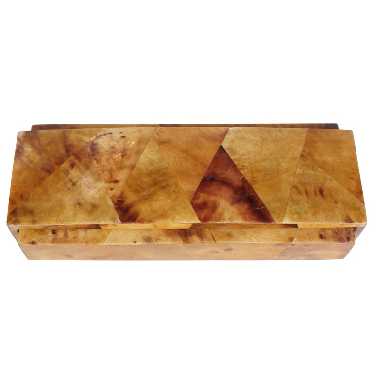Stunning lacquered pen shell decorative box in hues of tortoise. The box features mosaic inlays with geometric patterns. Streamline form with waterfall lid design and palmwood interior. Mid-Century Modern inspired design in the style of Karl