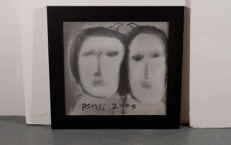 Abstract figural artwork depicting two faces in monochromatic hues black, grey, and beige. The painting also features the two characteristic birds which are components in all of the artist's works. In custom ebonized wood frame and signed by the
