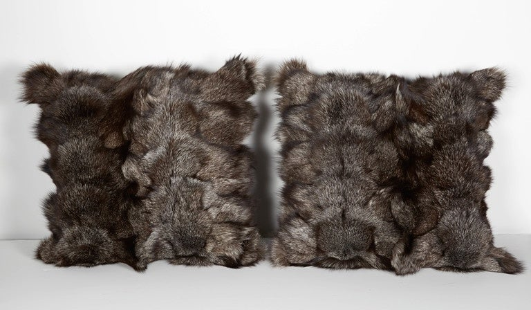 Luxury throw pillows in stunning fox hides in varying hues of grey. All handcrafted, featuring fine cashmere backing in charcoal grey. Each pillow has been filled with plush, down-alternative inserts.  Sold separately at $875/each or $1,750/pair.