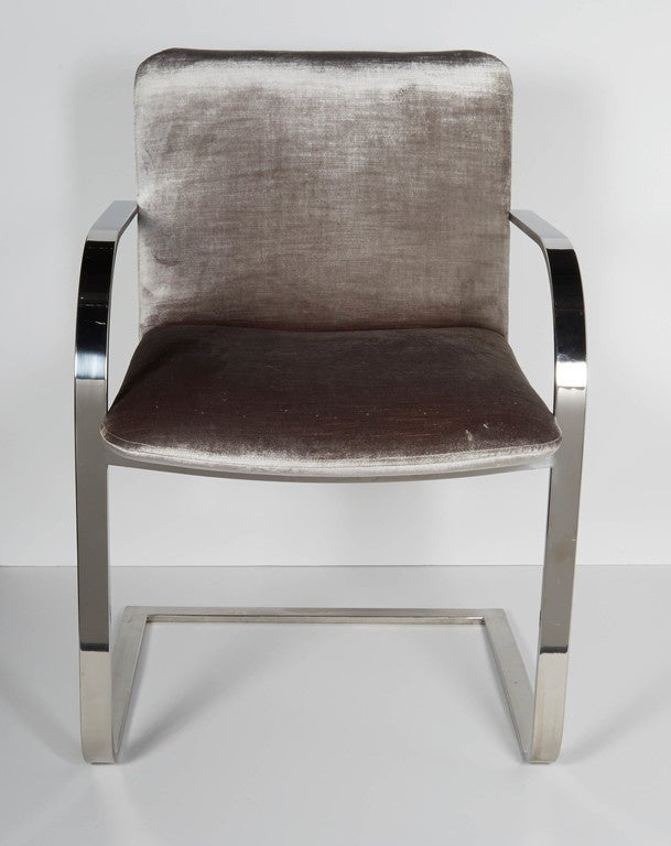 Mid-century modern cantilevered chairs in polished chrome with luxe platinum gray velvet. Beautiful curved arm and frame design with floating seat cushions. Great as dining chairs or as desk chairs.