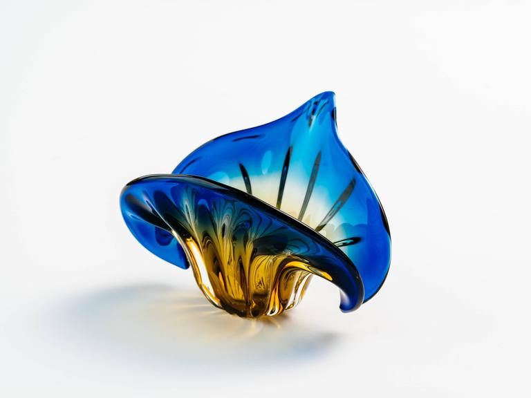 French Art Deco bowl or vase comprised of handblown Murano glass in gradient colors of marigold yellow, amber, and royal blue. The vase has a fleur-de-lis or flower of the lily design. It features fluted accents with winged sides and tapered tip