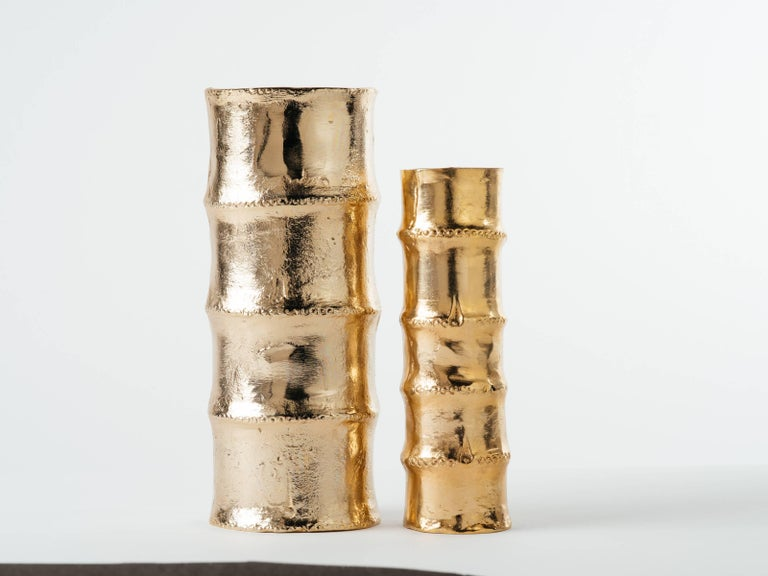 Exquisite pair of Mid-Century Modern style sand cast bamboo vases. 24-karat gold plating over metal alloy, or cast iron. Large vase measures 12