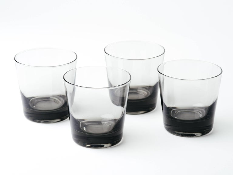 Set of four Scandinavian Modern double old fashion cocktail glasses. Handblown in hues of smoked grey or translucent black.