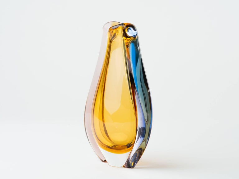 Stunning pair of Bohemia sculptural art glass vases. Handblown vases have a teardrop or tulip form with submerged technique, creating several layers of glass in contrasting colors. Made for Skrdlovice Glassworks in the mid-1950s, and has original