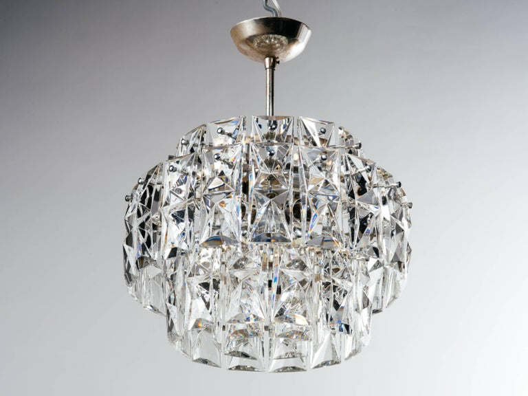 Stunning Mid-Century Modern cut crystal chandelier with multiple tier design. Has single and double length faceted crystals. Chrome frame and stud fittings and equipped with ten lights. Newly rewired.