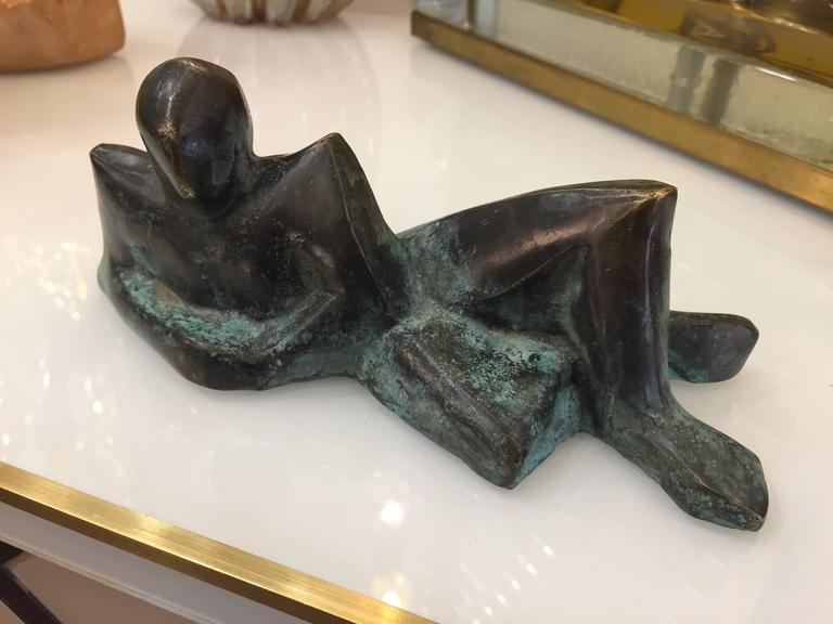 A charming contemporary little bronze, very limited edition, in a very expressive reclining posture, yet minimalist, very attractive on all sides softened with antique finish, signed by the Italian artist Giovanni Ginestroni. Every piece by