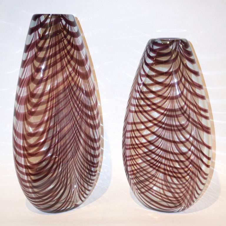 Precious vintage Art sculpture vases by Formia in overlaid blown crystal clear Murano glass with organic Fenicio decoration in an unusual purple brown color. This heated decor technique consists in applying vitreous threads of Murano glass to the