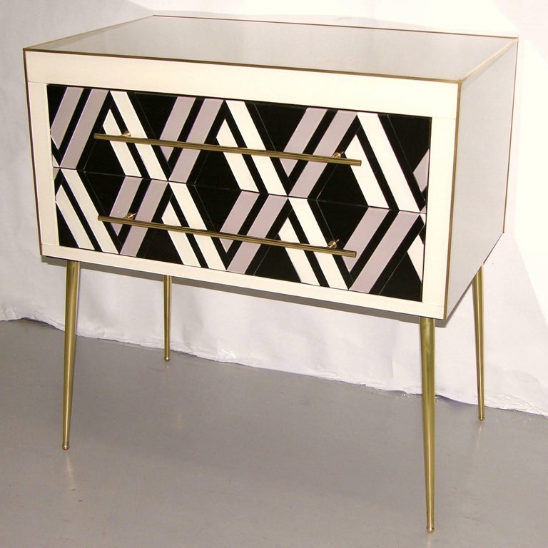 1990s Italian modern two-drawer end tables / nightstands, entirely handcrafted, the surrounds finished at the back as well in cream white glass so that these pieces can be displayed also in the middle of a room, the fronts with an Escher inspired