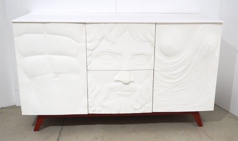 Exclusive made in Italy contemporary credenza or dresser with a Renaissance flair, the three front panels in bas-relief reinterpreting iconic ancient Green and Roman art. High quality of execution and materials, the handcrafted white lacquered