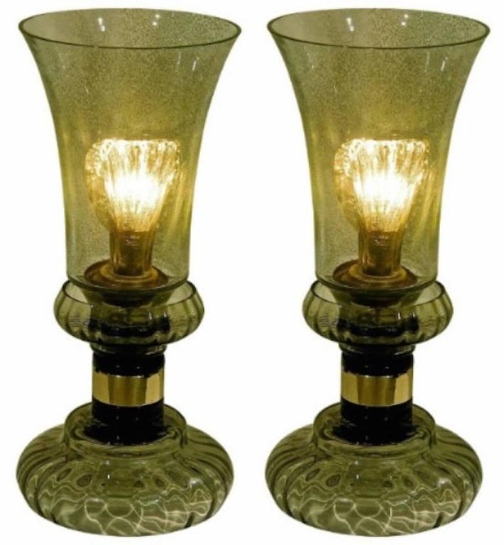 A very elegant pair of table lamps in blown Murano glass by Cenedese in a very rare color, a refined smoked grey with a hint of green. The flared upper body is worked with dust inclusions in the glass, reminiscent of the Laguna Gemmata pieces by